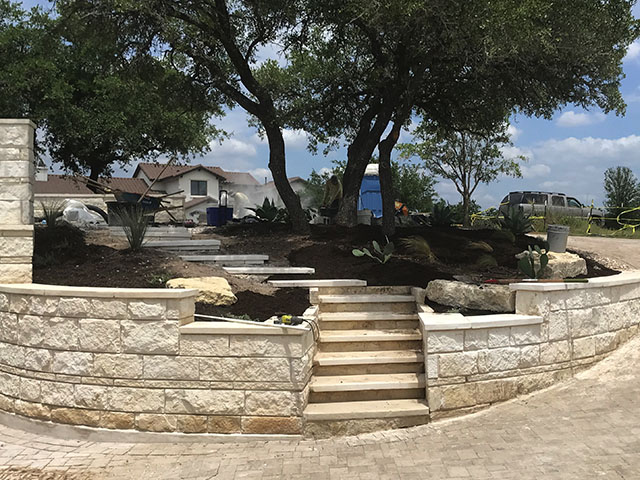 custom retaining walls and flower beds